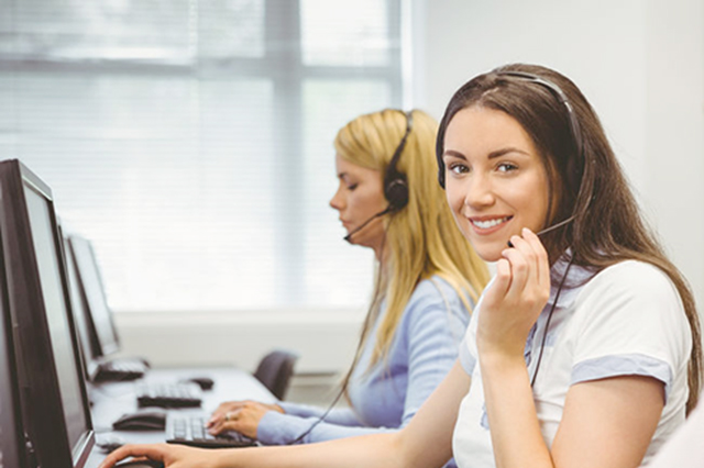 Image of  call centre staff wearing headsets